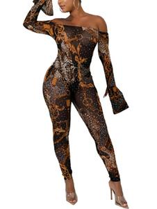 Completo estivo attillato in misto cotone leggero a maniche lunghe con spalle scoperte e stampa animalier gialla