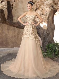 Vestido de novia de tul de color champaña de cola barrida