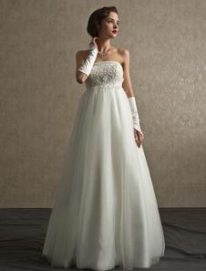 Vestido de novia de tul con escote palabra de honor y cuentas con cola desmontable