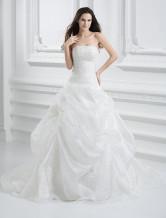 Vestido de novia de organza con escote palabra de honor y aplicación de cola larga