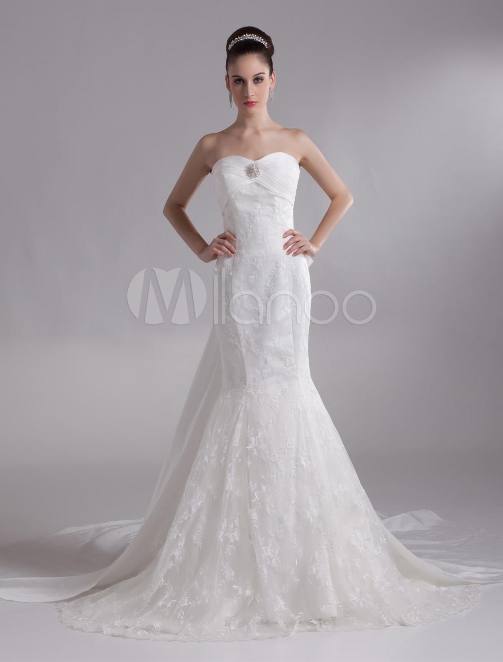 cf27f5a56 Vestido de novia marfil con encajes y escote de corazón de cola larga de  estilo Sirena ...