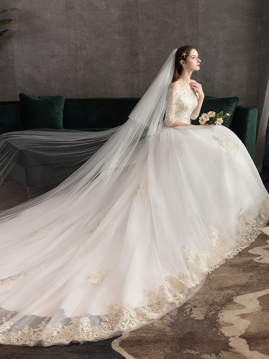 Robes de mariée princesse dentelle ivoire