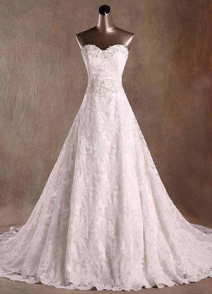 vestido de novia de encaje de color marfil con diamantes de