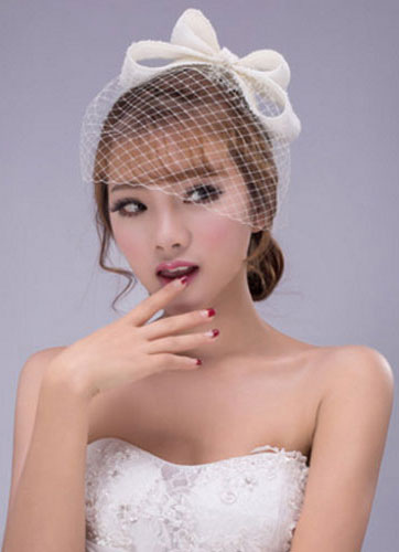 Ivory Bow Wedding Hat with Birdcage Veil
