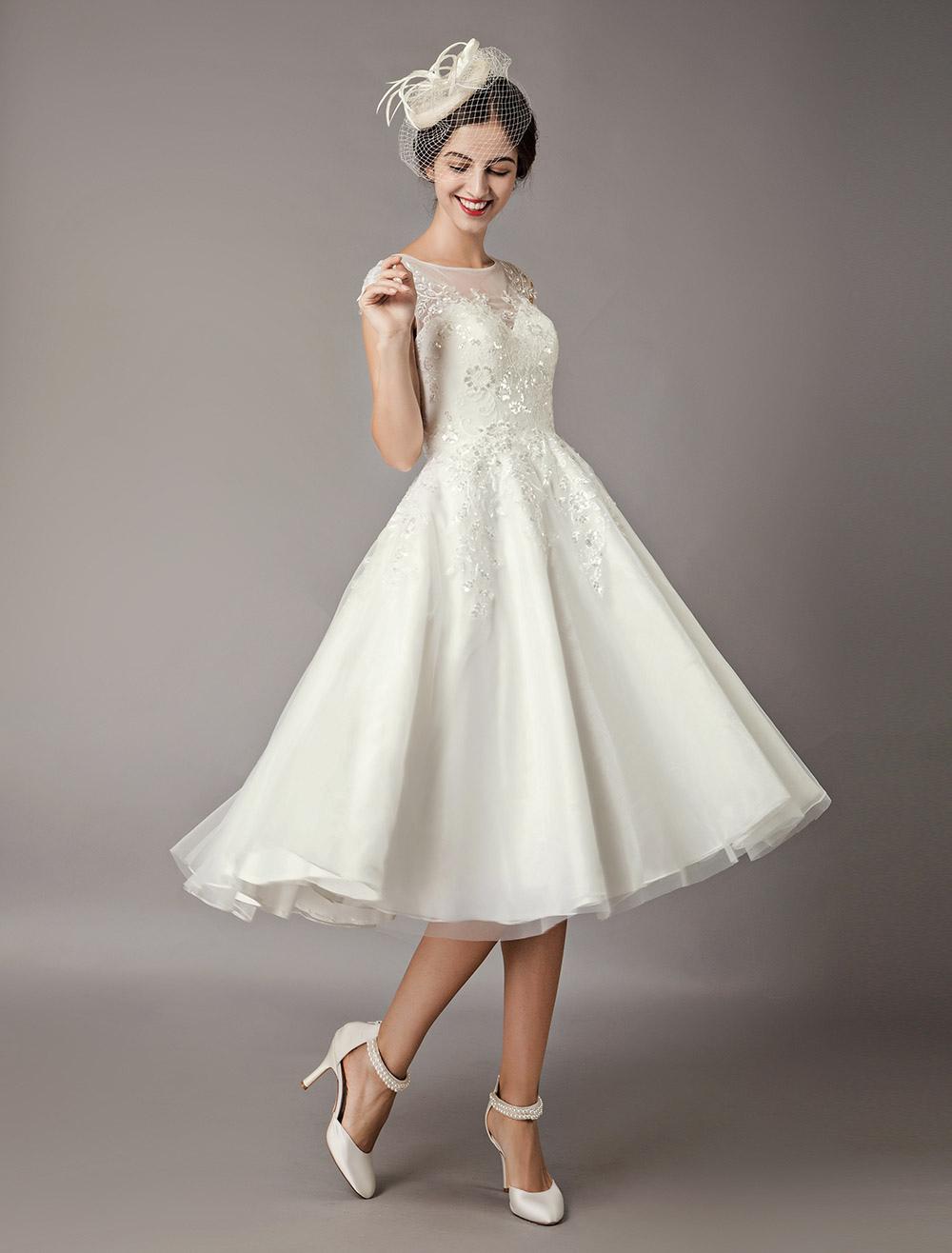 66d839fc973e ... Abito da sposa vintage 2019 Abiti da sposa vintage avorio corto in  tulle con paillettes e ...
