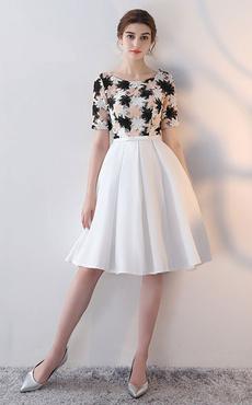 9015673cd7 Vestido de cóctel blanco con escote redondo con manga corta con lazo