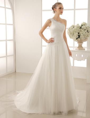 5dbee035c1 Vestido de novia de tul marfil con escote a un solo hombro