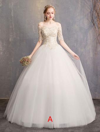 4efeb689e0 Vestido de novia en tul con hombros descubiertos y media manga princesa  vestido de novia